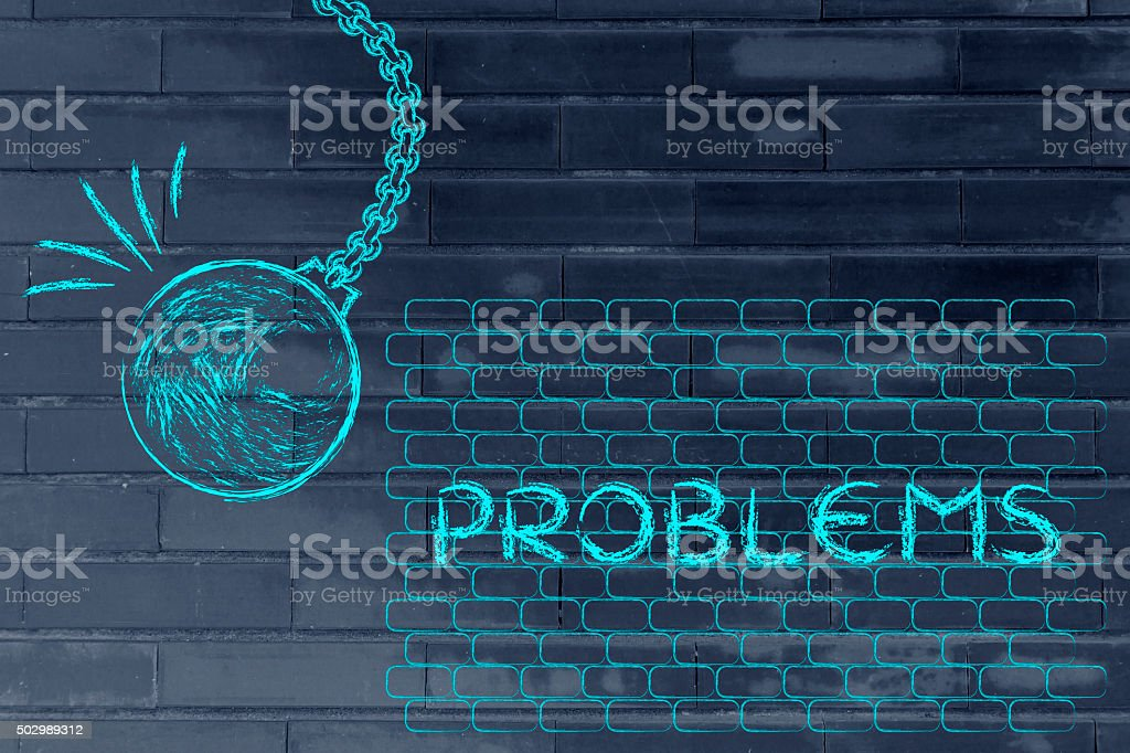 wrecking ball destroying a wall with the text Problems stock photo