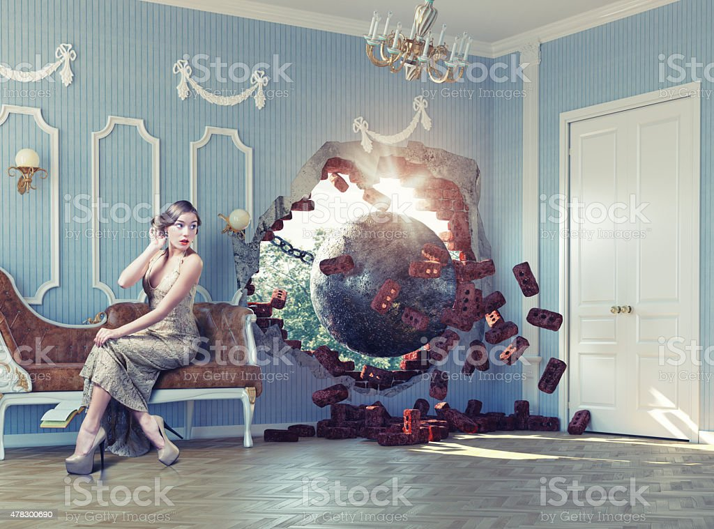 wrecking ball in the room and the woman stock photo