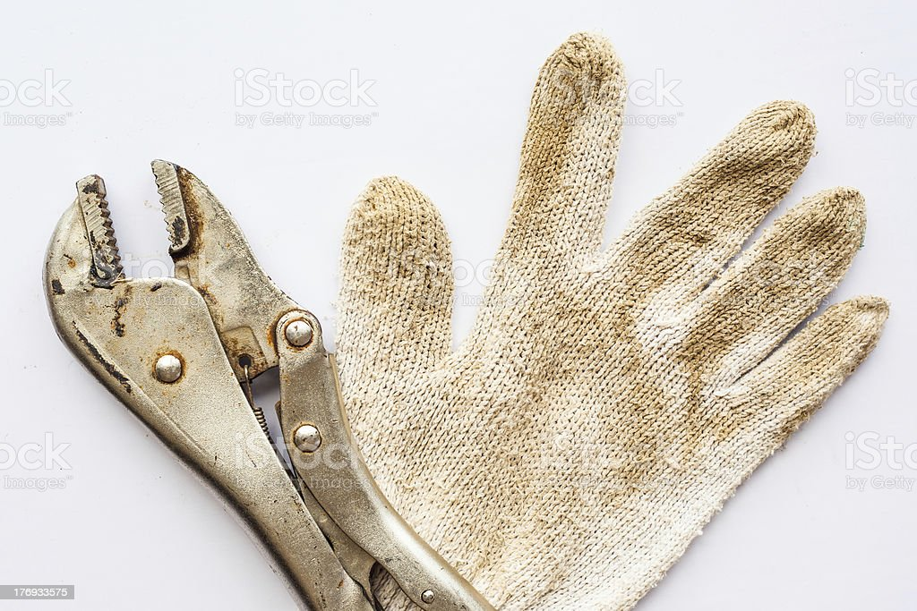 Wrench and gloves on white background. royalty-free stock photo