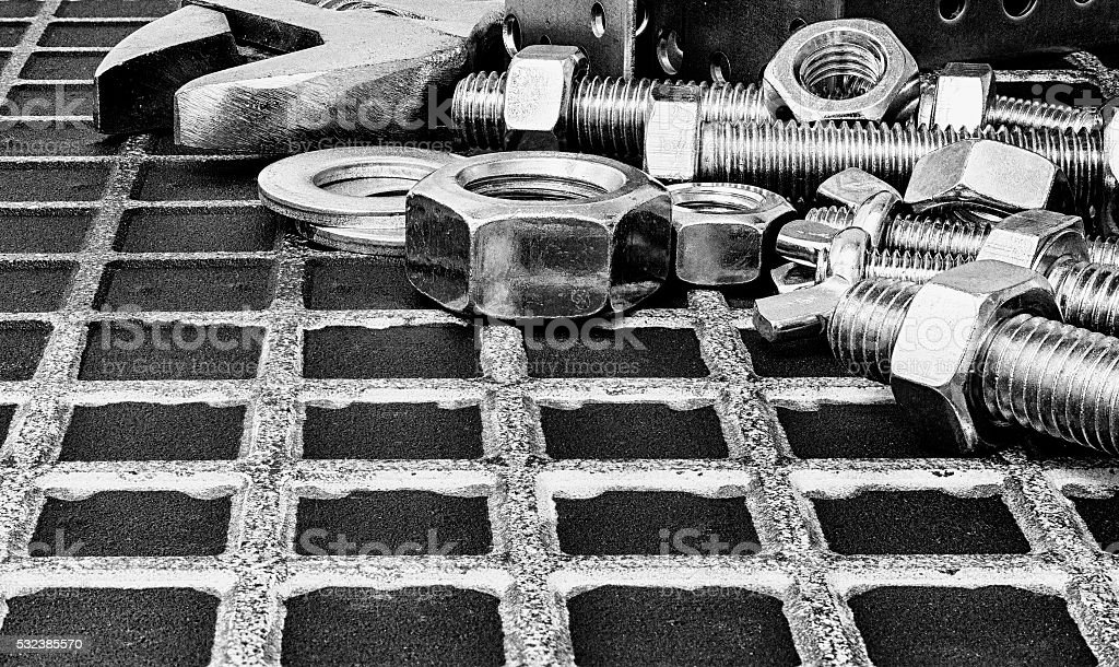 Wrench and nuts and bolts. stock photo