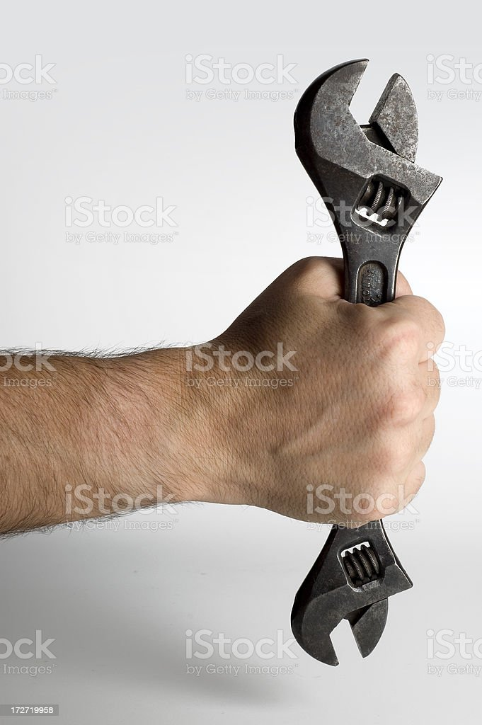 Wrench in hand w/Clipping path royalty-free stock photo