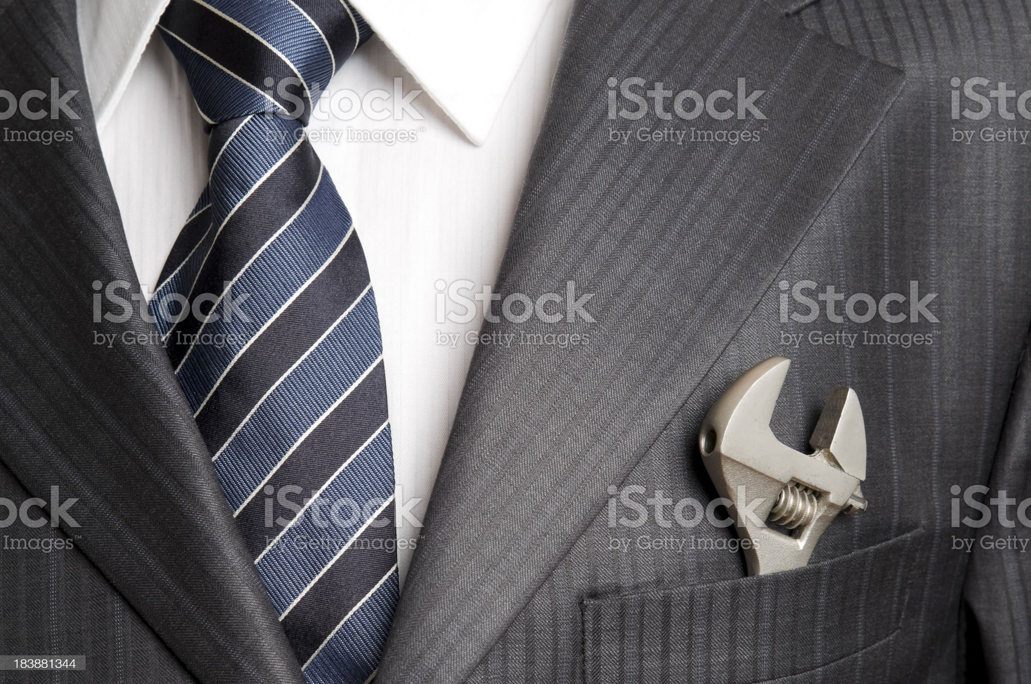 Wrench in pocket of businessman royalty-free stock photo