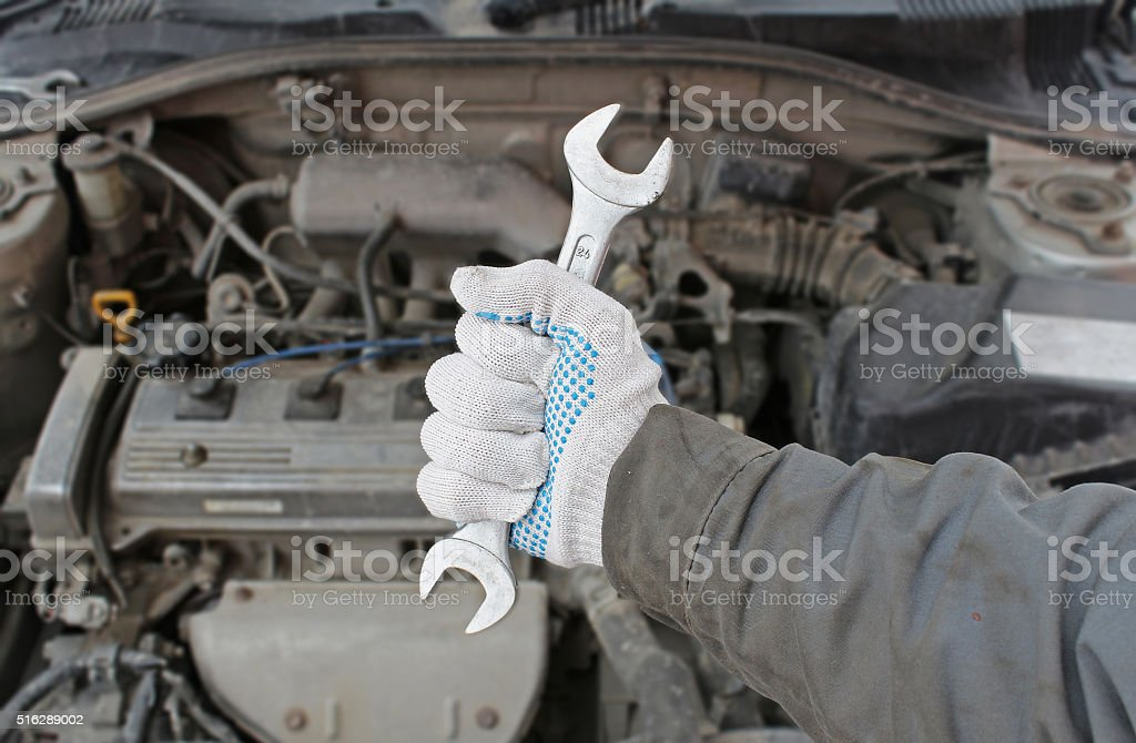 Wrench in the hand of auto mechanic stock photo