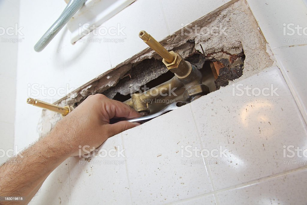Wrench on a Shower Faucet royalty-free stock photo