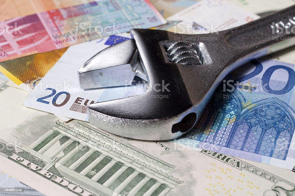 Wrench on money stock photo