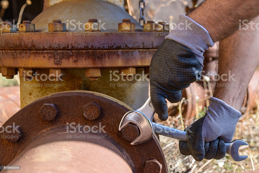 Wrench tightens a bolt stock photo