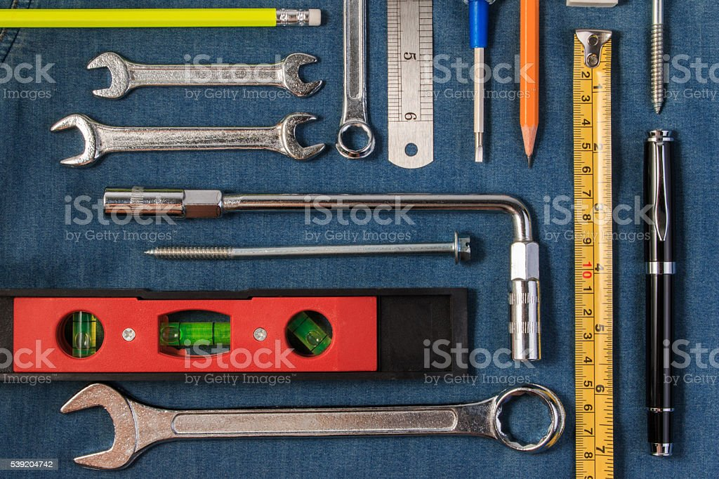 Wrench tools on a denim workers. Flat lay style. stock photo
