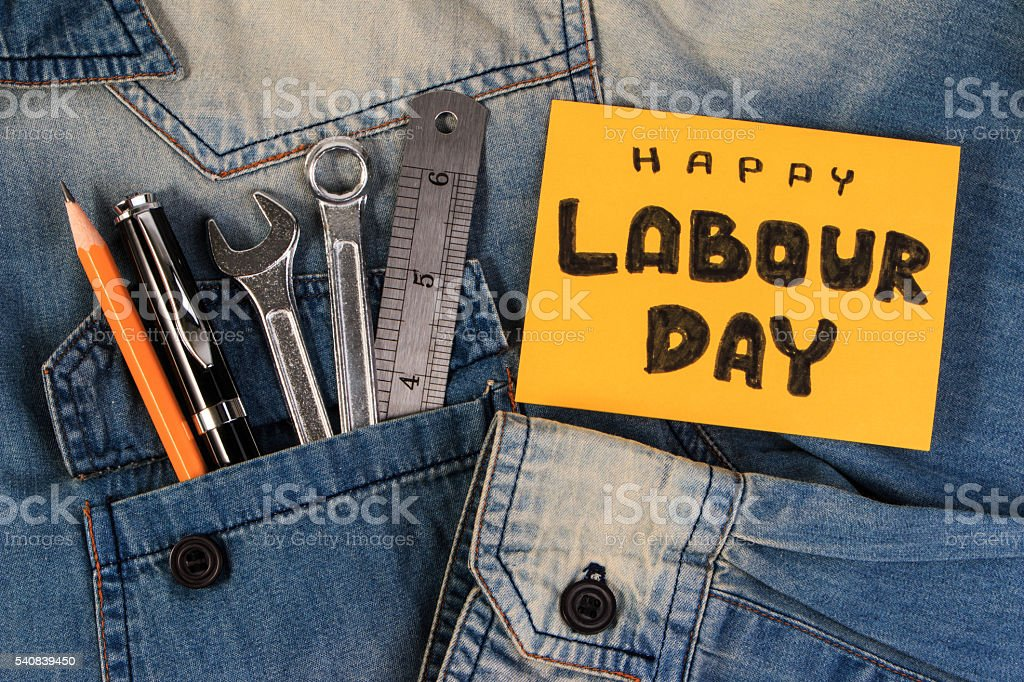 Wrench tools on a denim workers. Happy Labour Day. stock photo