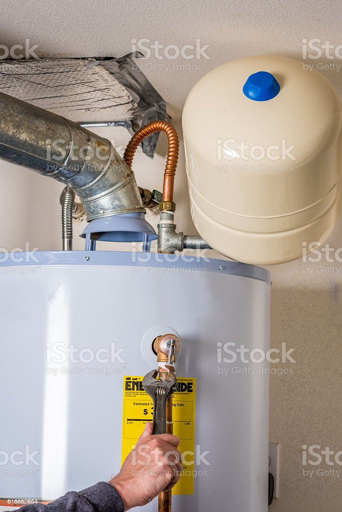 Wrench used to work on a water heater stock photo