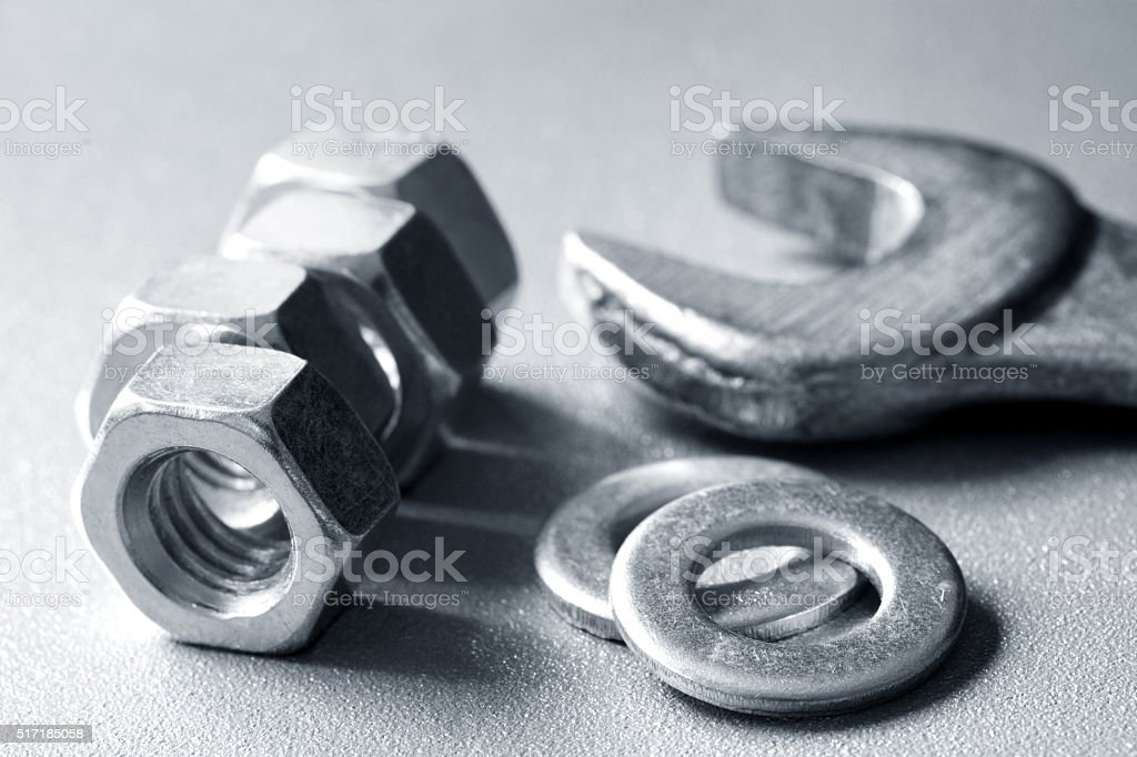 Wrench, washers and nuts stock photo