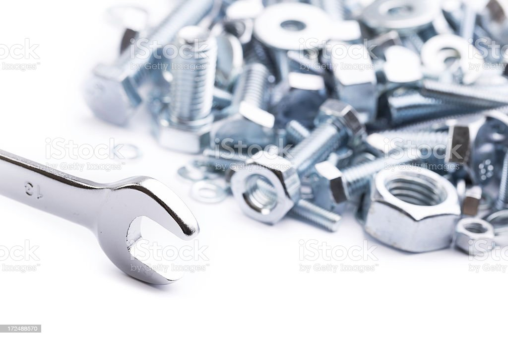 wrench with nuts and bolts royalty-free stock photo