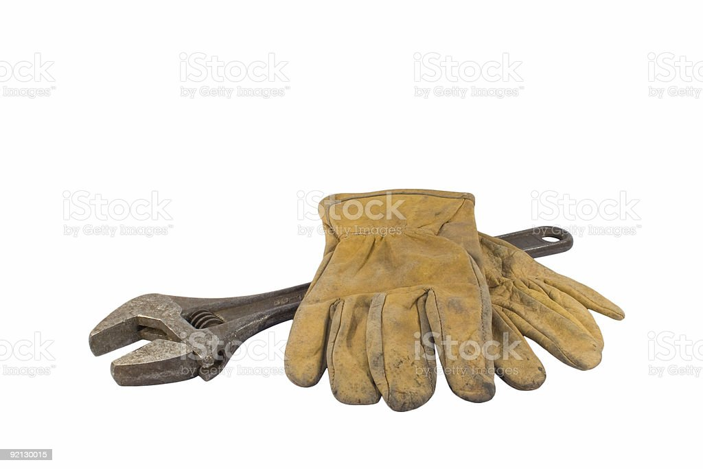 Wrench with work gloves royalty-free stock photo