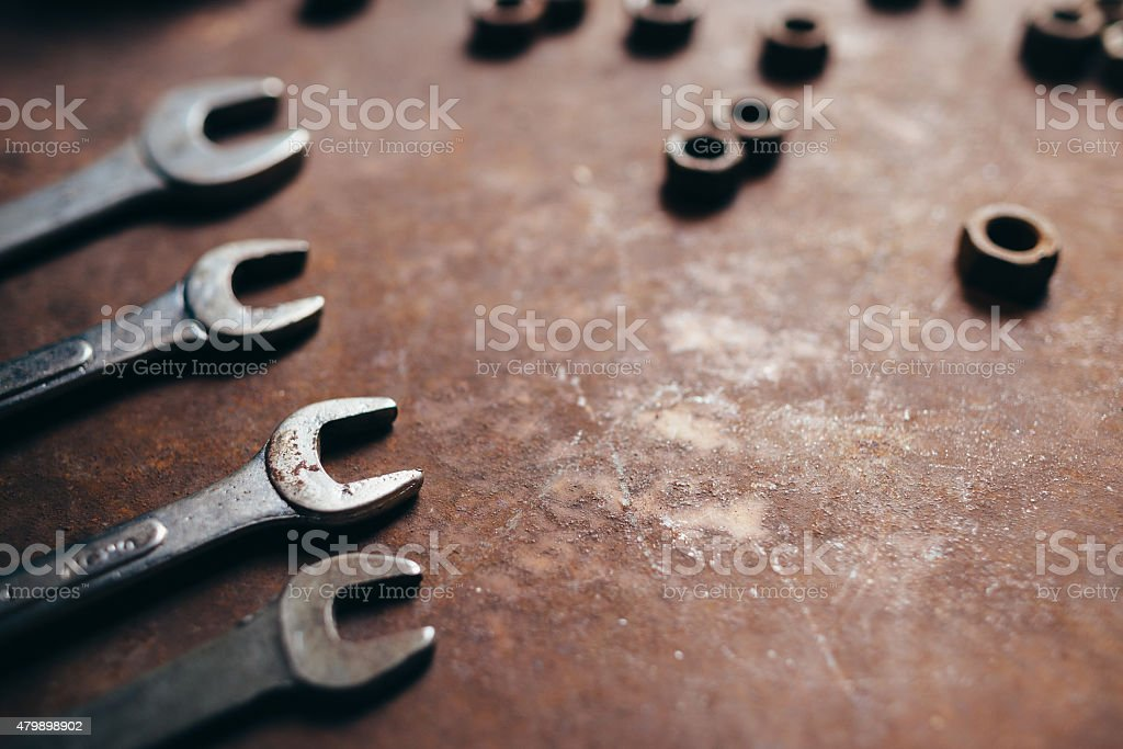 Wrenches and nuts metal background stock photo