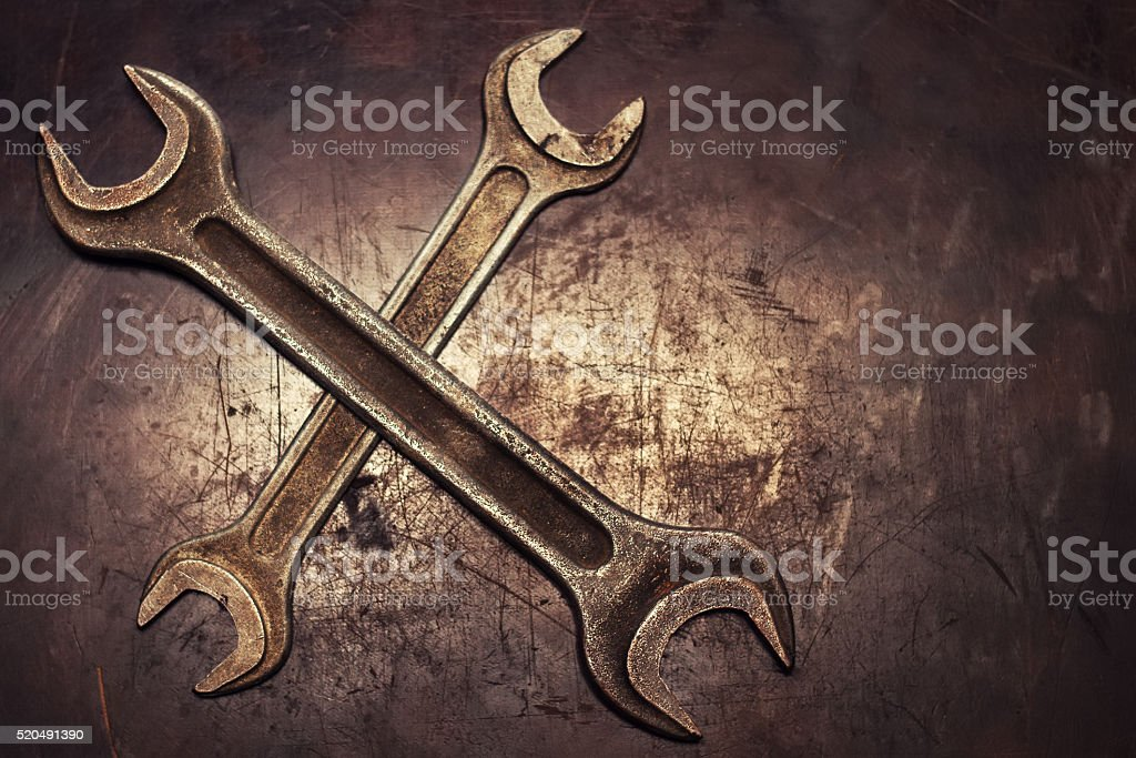 wrenches on grunge background top view stock photo