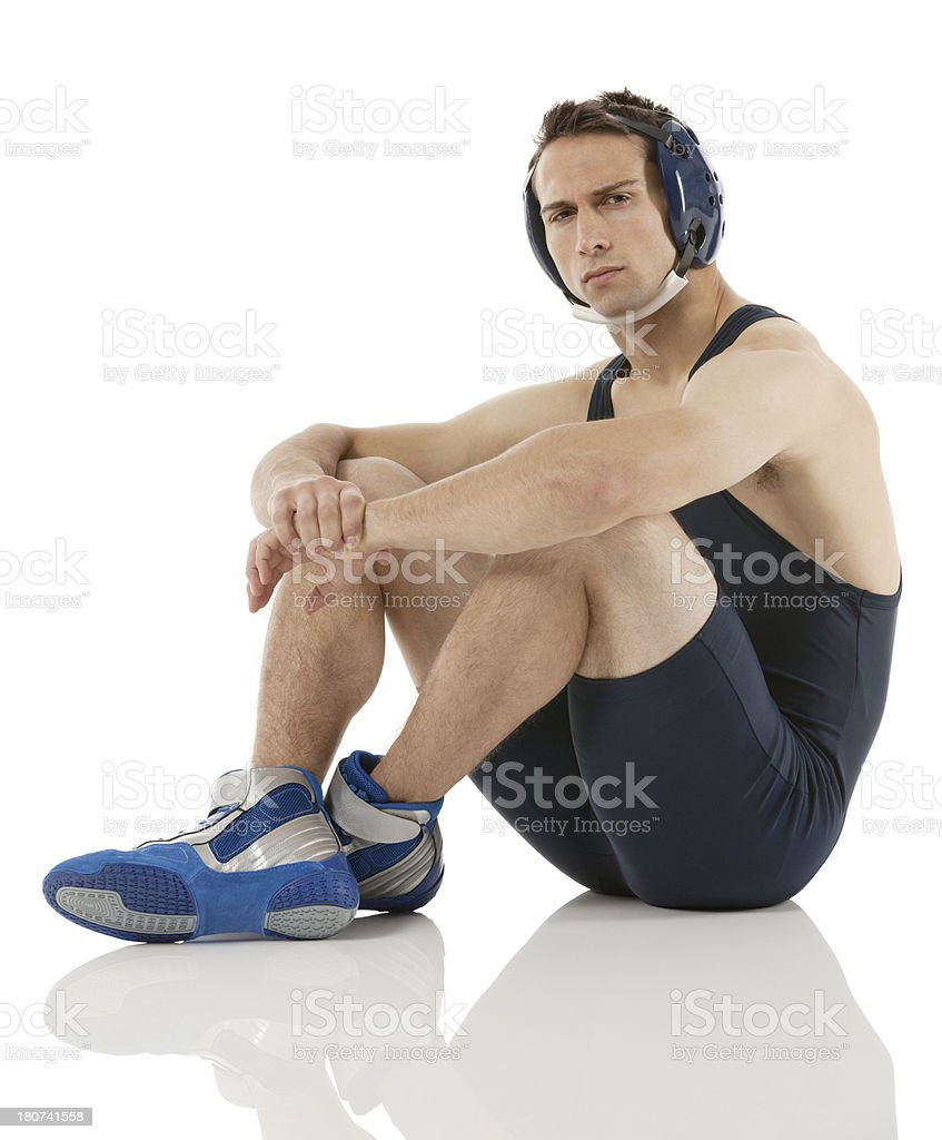 Wrestler sitting on floor royalty-free stock photo