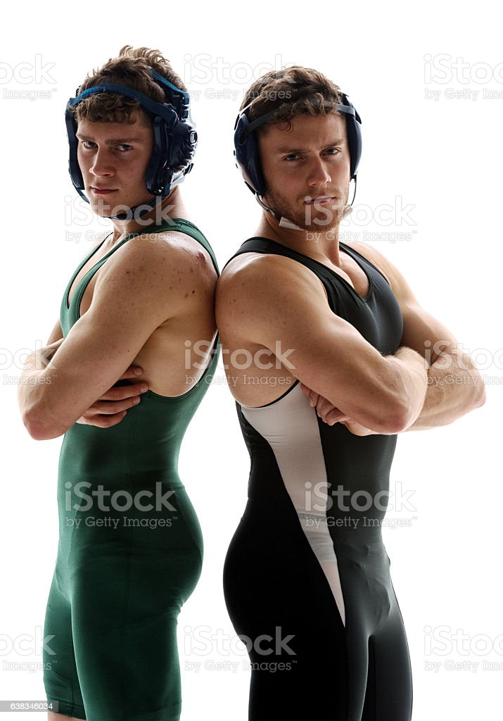Wrestlers standing with arms crossed stock photo