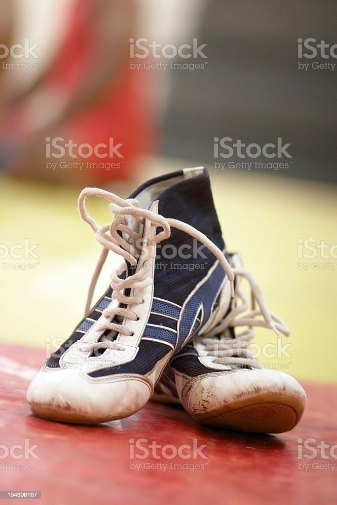 Wrestling boots at the gym stock photo