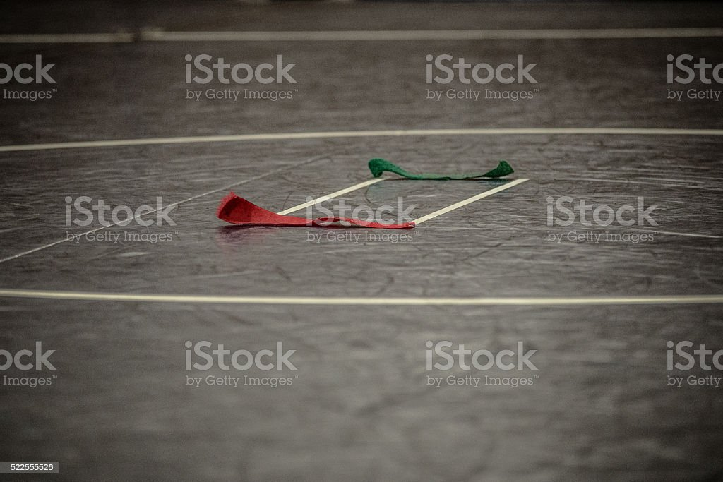 wrestling mat and colored straps stock photo
