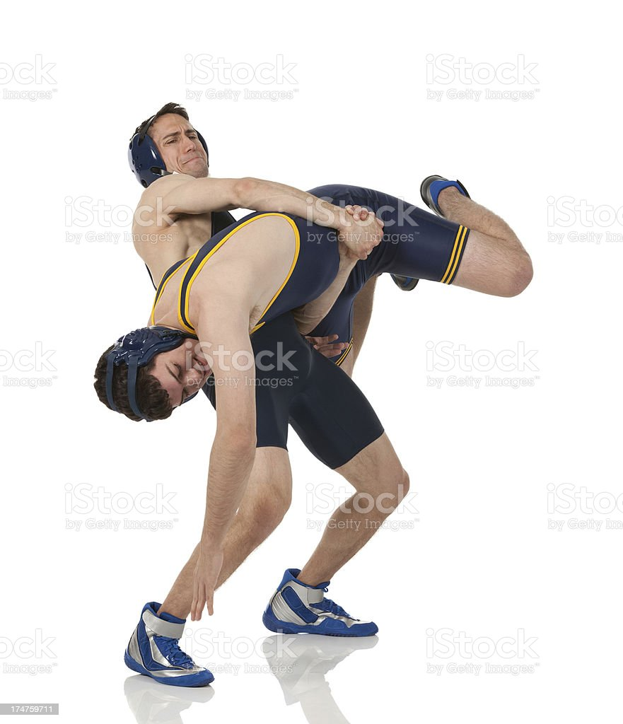 Wrestling match in progress stock photo