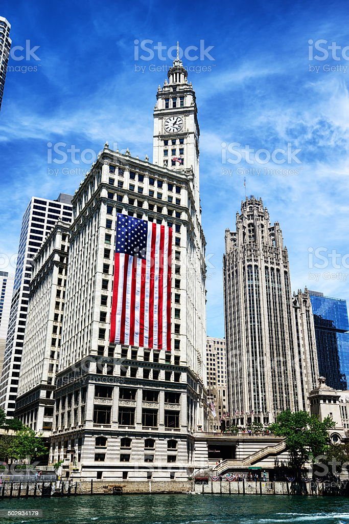 Wrigley Building with large American flag stock photo