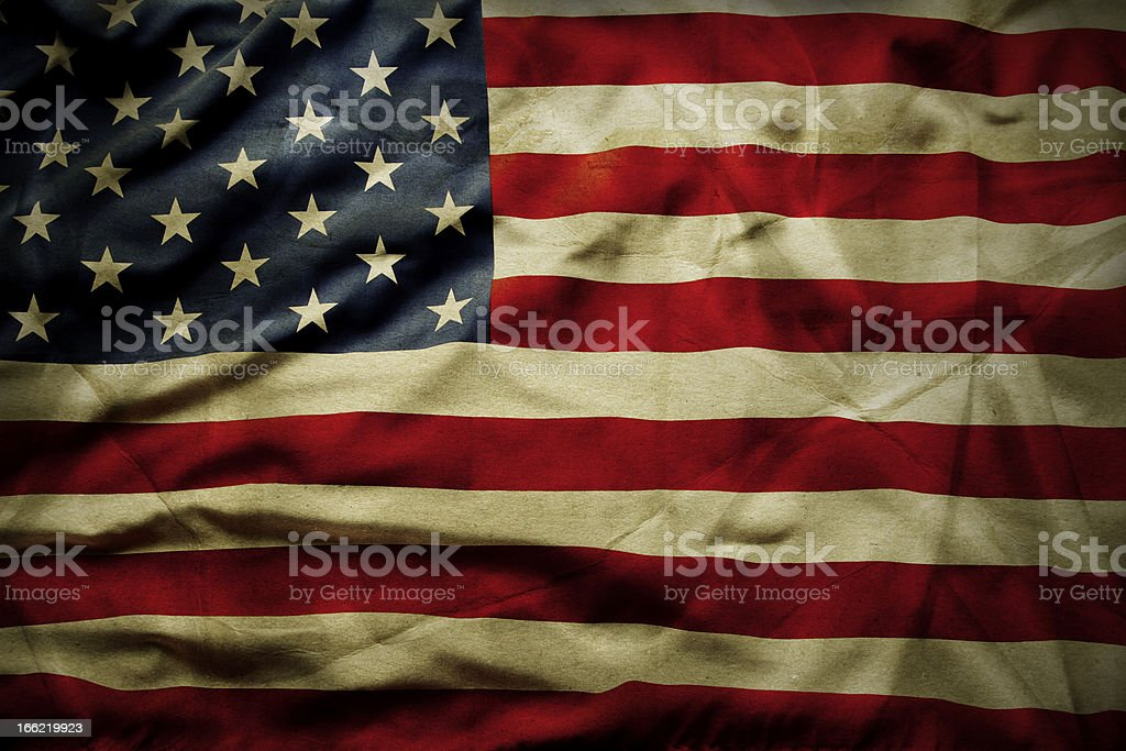 Wrinkled and tea stained American flag stock photo