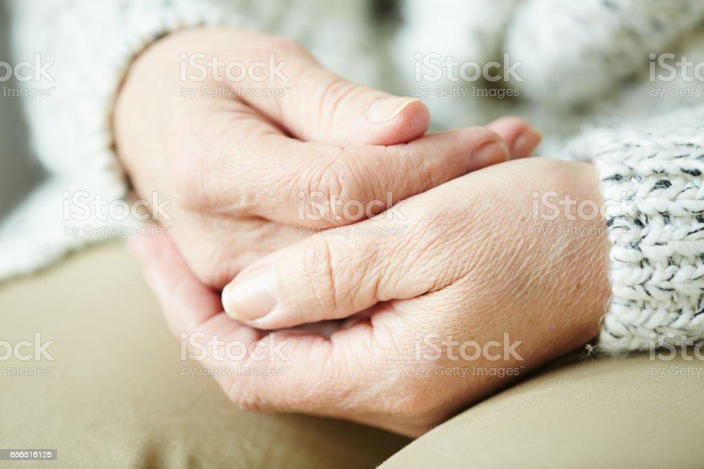Wrinkled female hands stock photo