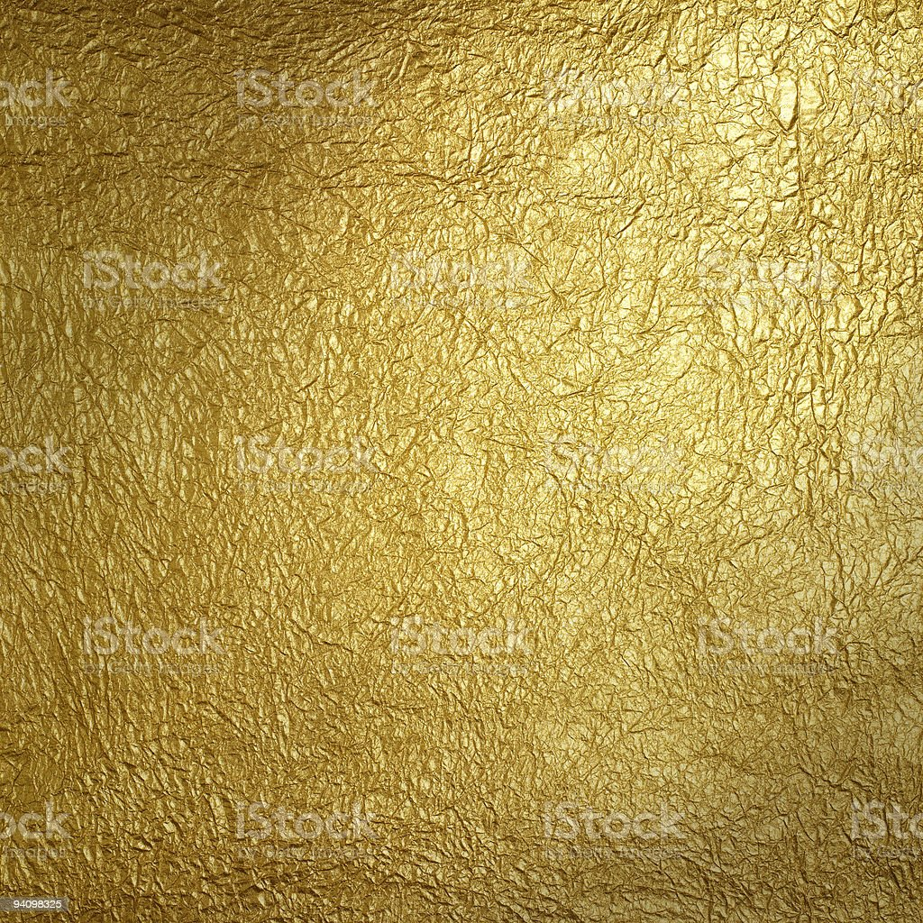 Wrinkled golden surface plate stock photo