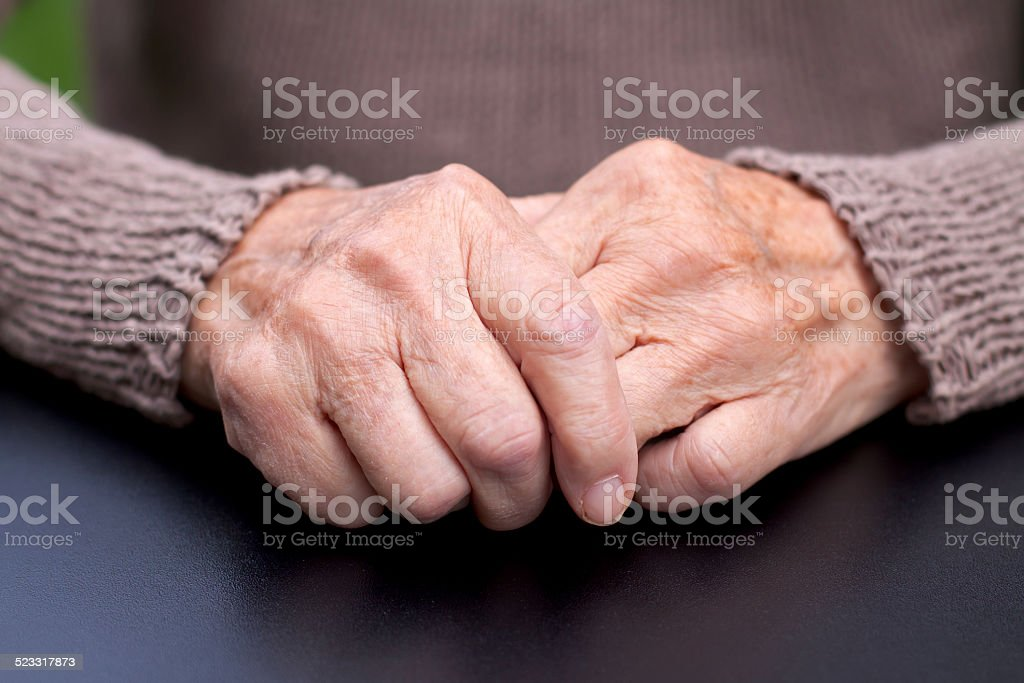 Wrinkled hands stock photo