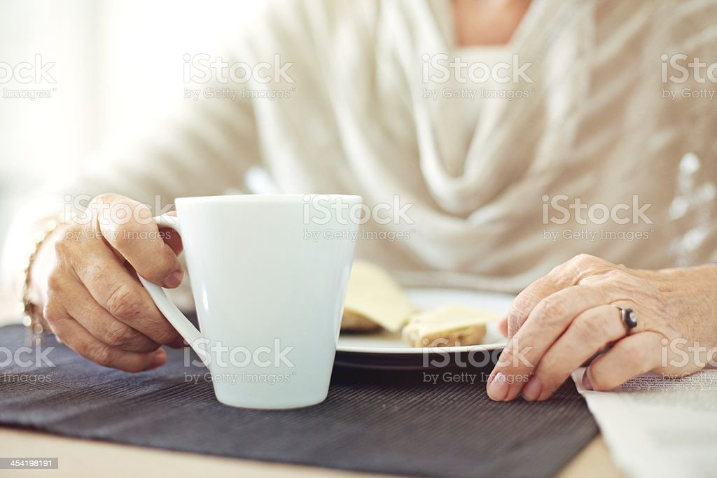 Wrinkled Hands with a Cup of Coffee stock photo