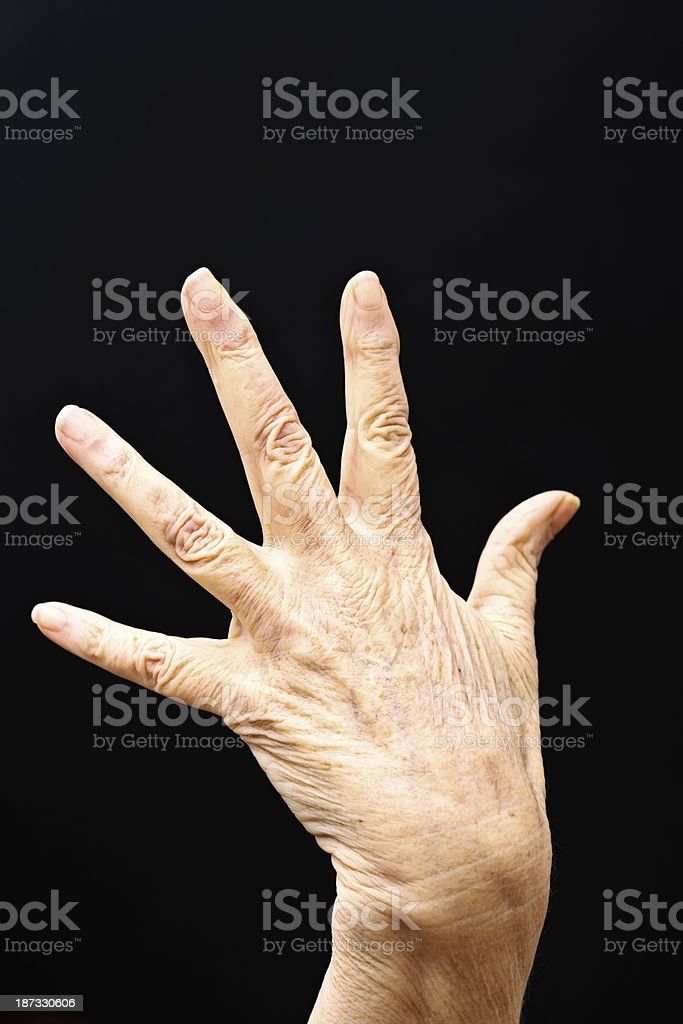 Wrinkled old hands with age spots stock photo