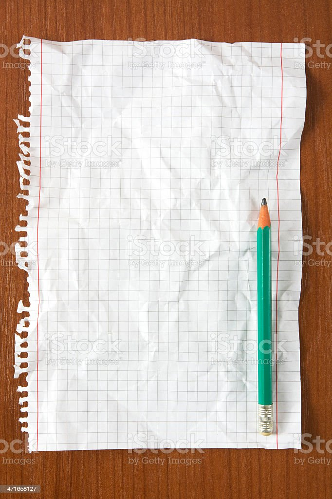 Wrinkled paper and pencil on table royalty-free stock photo