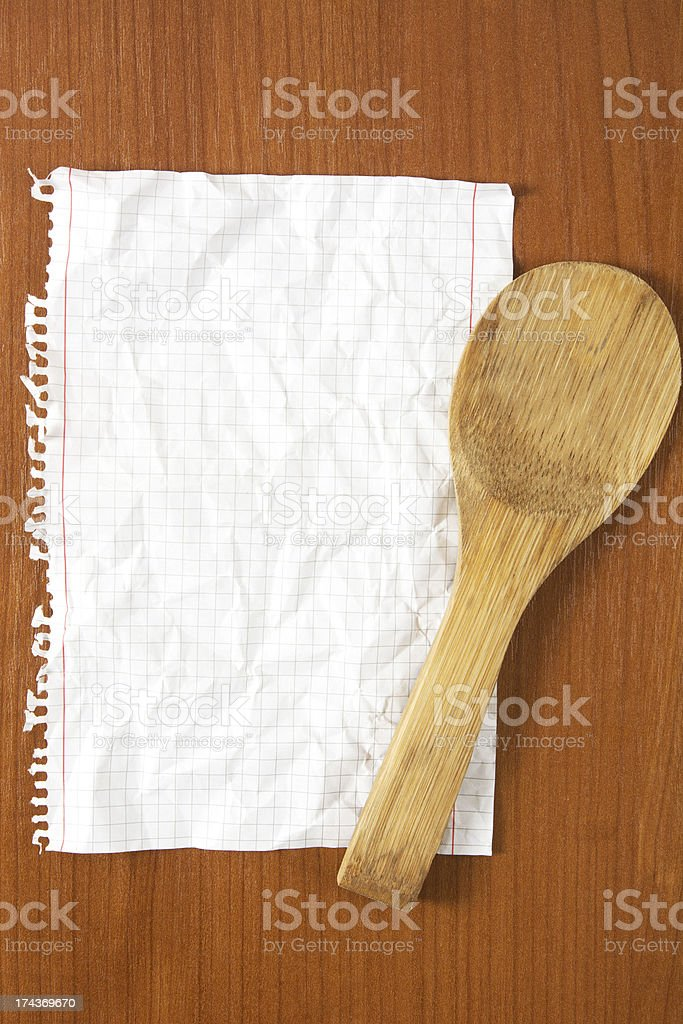 Wrinkled paper and wooden spoon royalty-free stock photo