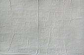 Wrinkled paper glued on wall texture