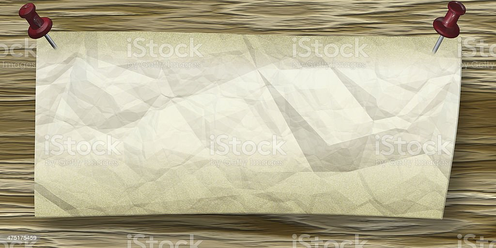Wrinkled Paper with push pins to wooden wall royalty-free stock photo