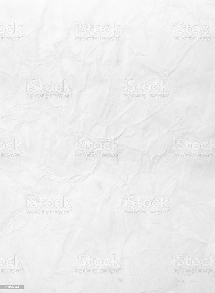 Wrinkled piece of paper against a white background stock photo