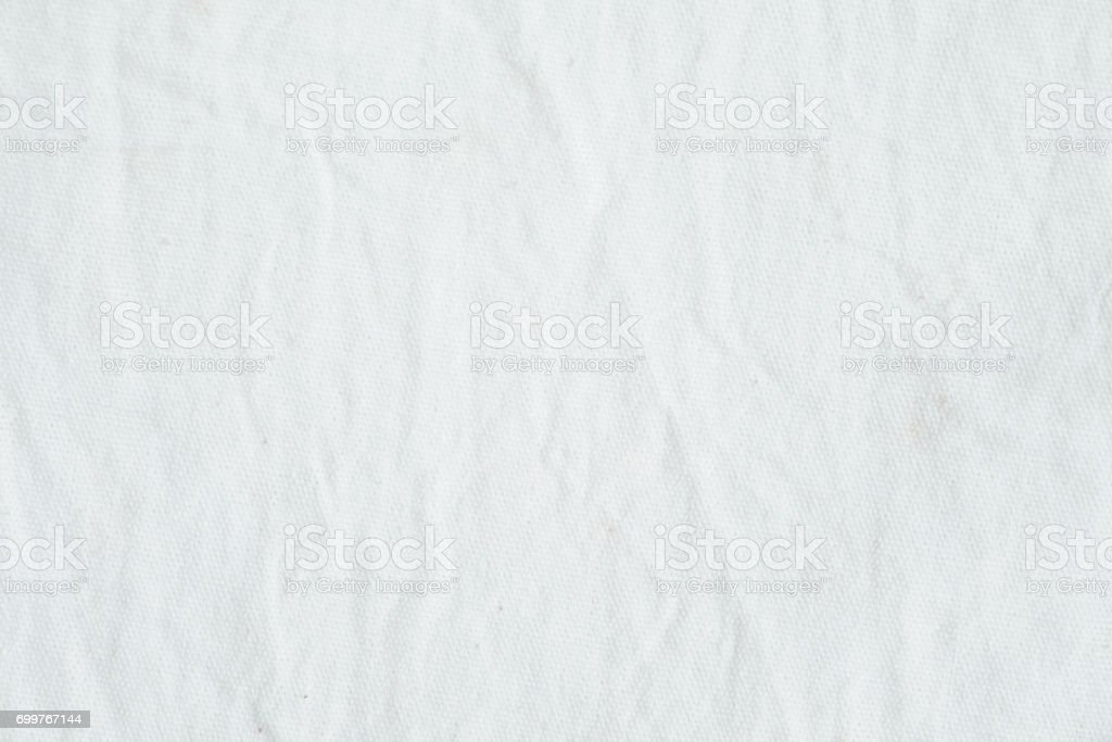Wrinkled white cotton canvas fabric textured background, wallpaper stock photo
