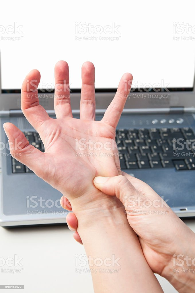 Wrist Pain due to Carpal Tunnel Syndrome while working stock photo