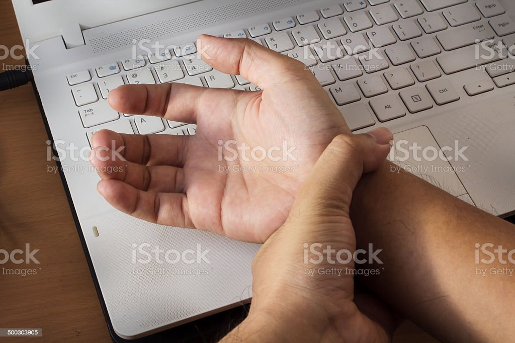 Wrist pain from working with computer,Carpal tunnel syndrome stock photo