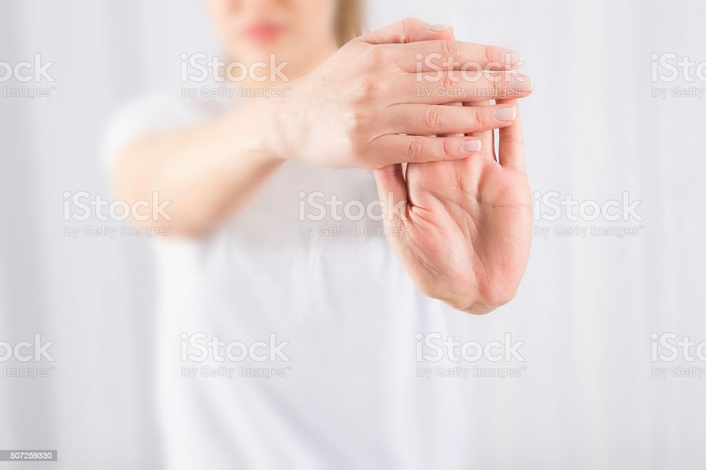 Wrist stretch stock photo