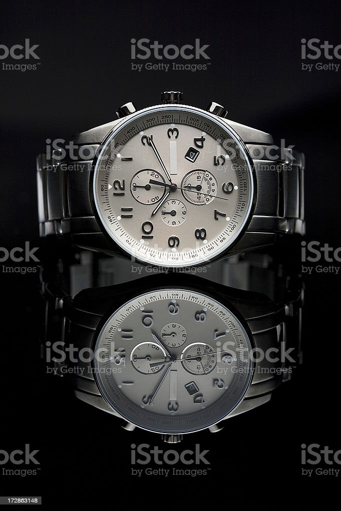 Wrist watch lying, beautiful reflection stock photo