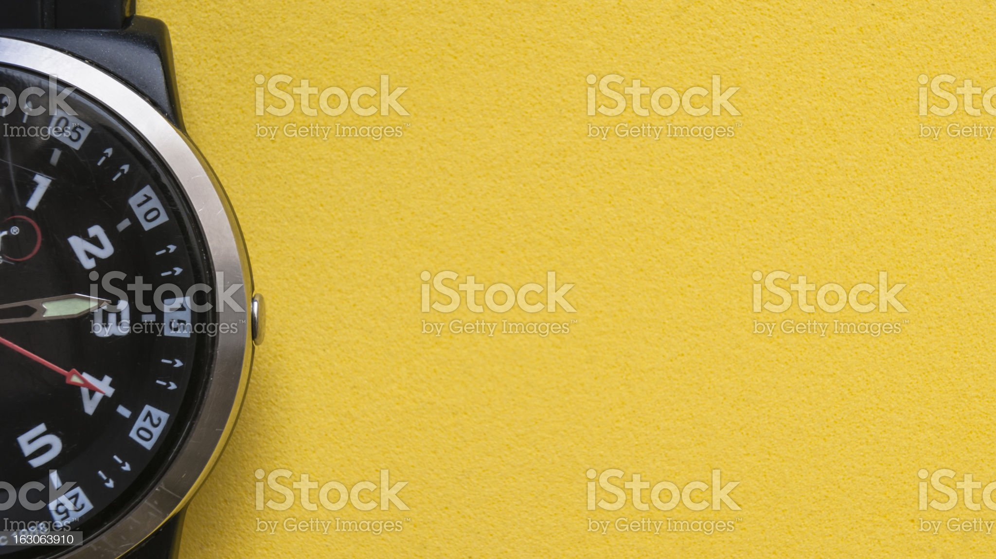 Wrist watch On a Yellow Background royalty-free stock photo
