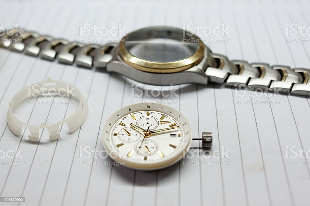 Wrist watches on book stock photo