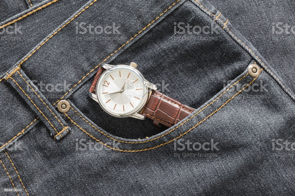 Wristwatch in denim jeans pocket stock photo