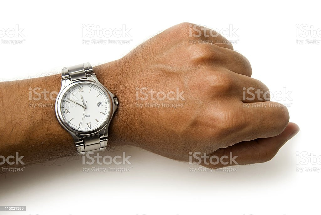 Wristwatch on a wrist - clipping path stock photo