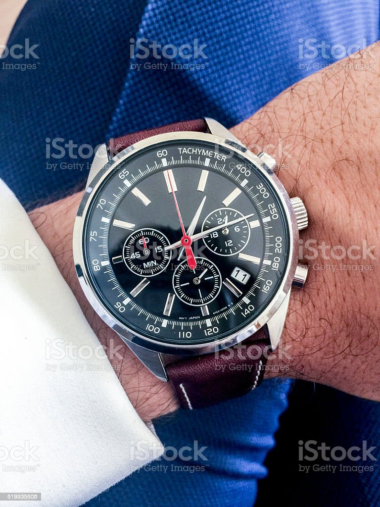 Wristwatch on a wrist stock photo