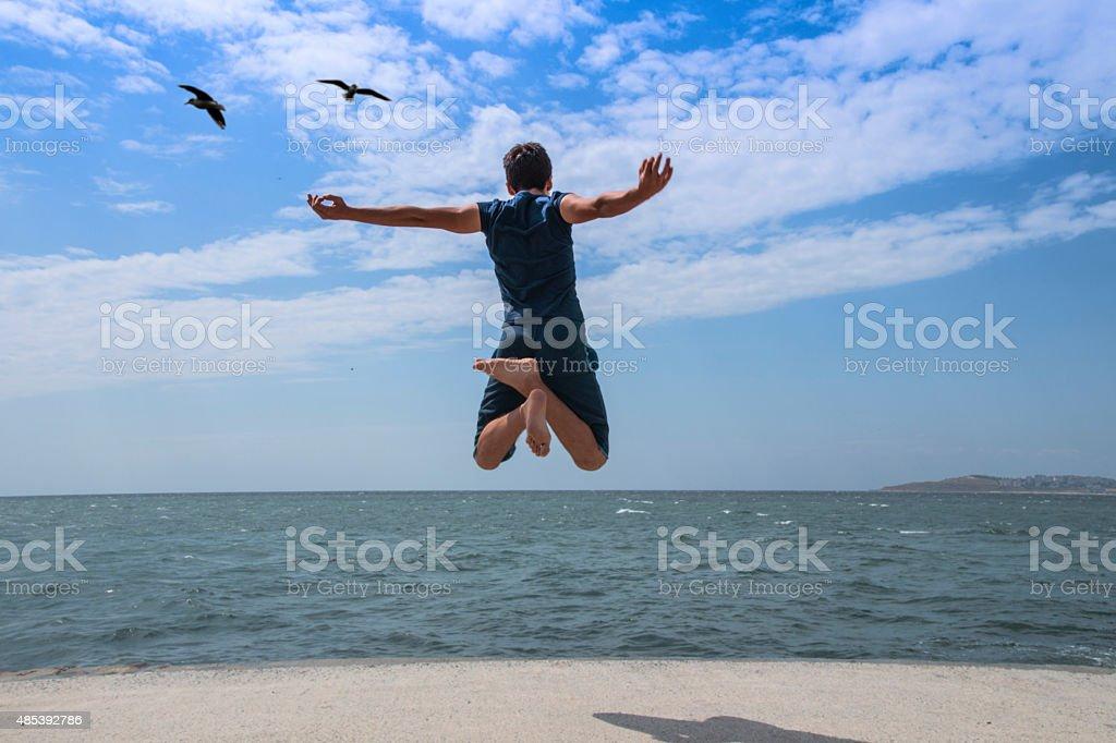 Write jump into the sea. stock photo