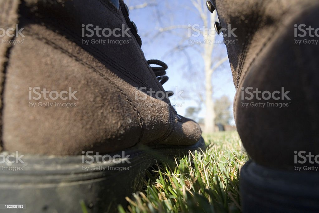 Write the title... Low angle view of two shoes. royalty-free stock photo