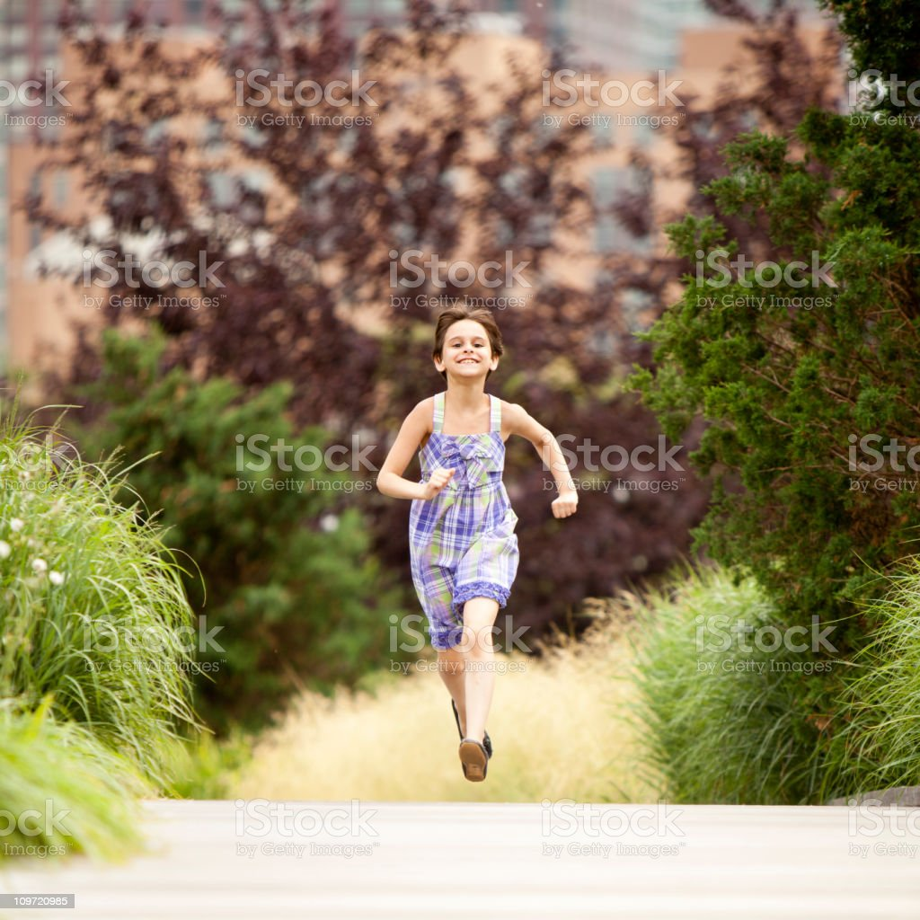 Write the title... Young girl running in the countryside. stock photo