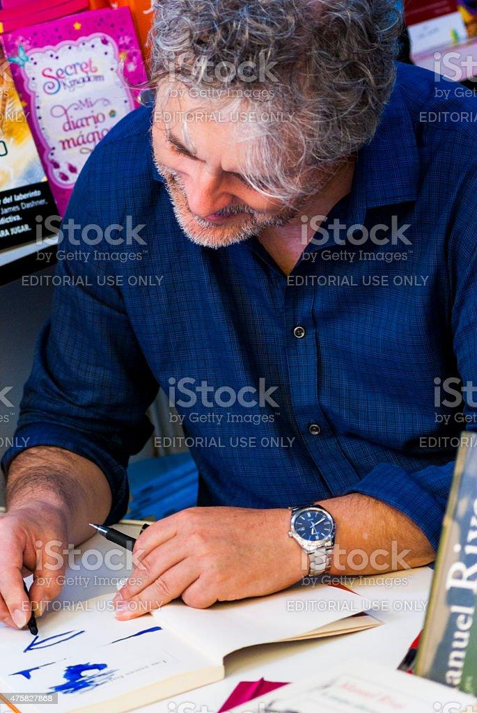 Writer Manuel Rivas signing copies at the Madrid book fair stock photo