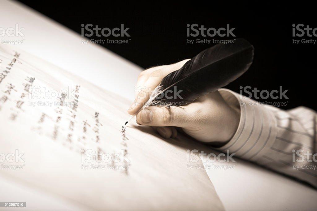writer writes a fountain pen on paper work stock photo
